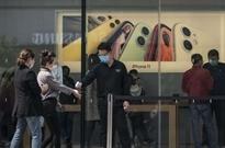 苹果:全球近百家零售店重新开业 进店都要带口罩