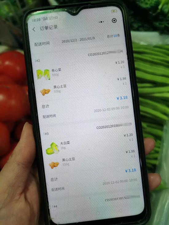 """菜场商户小程序""""淘菜猫云商户""""价格和销量,图源:采访对象"""